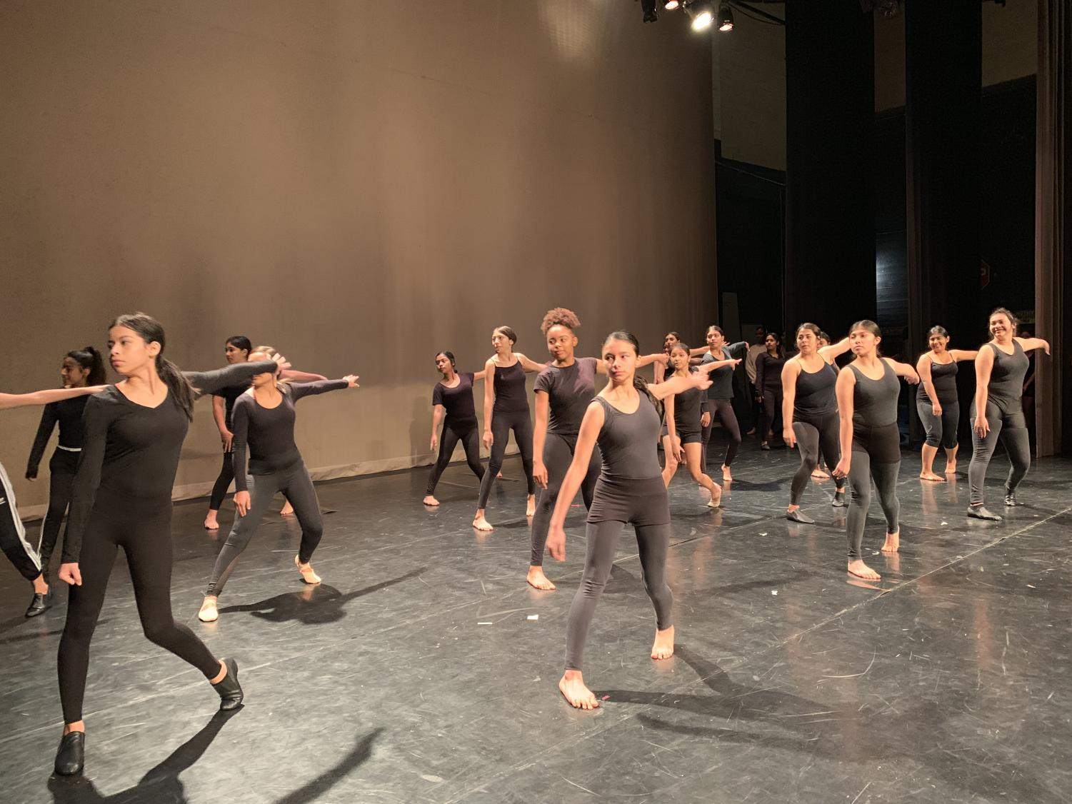 Beginning classes perform modern, ballet, and jazz combinations.