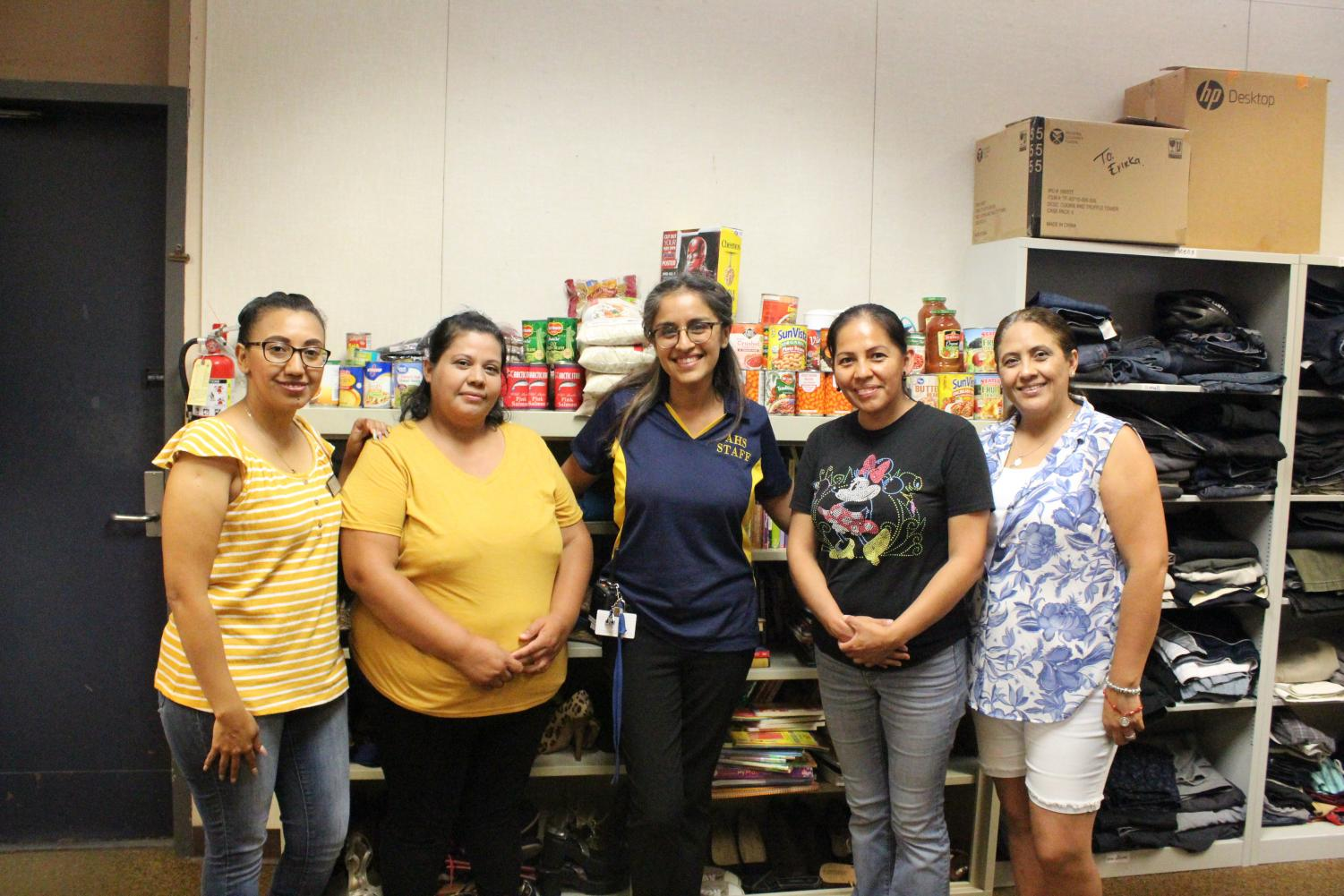 Parent volunteers help keep the Colonist Closet full of essentials for students.