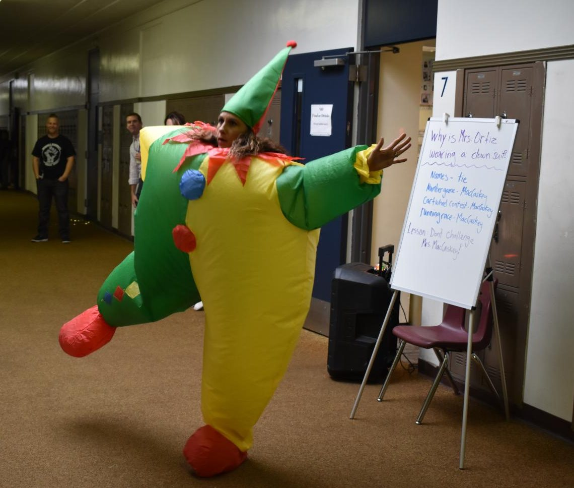 Mrs. Ortiz dancing in clown costume after losing a bet