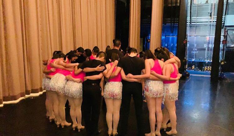 Dancers+pray+before+performance.+