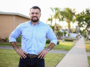 Avelino Valencia stands in his Anaheim Neighborhood.