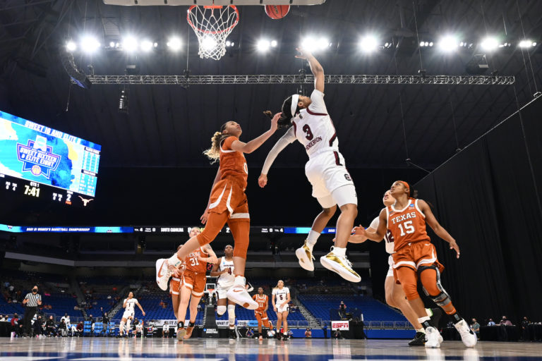 SAN ANTONIO, TX - MARCH 30: Destanni Henderson #3 of the South Carolina Gamecocks shoots a reverse lay up against the Texas Longhorns during the first quarter  in the Elite Eight round of the 2021 NCAA Womens Basketball Tournament at Alamodome on March 30, 2021 in San Antonio, Texas. (Photo by C. Morgan Engel/NCAA Photos via Getty Images)